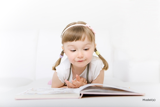 Shutterstock55180396j Girl with pigtails reading book Denver Plastic Surgery